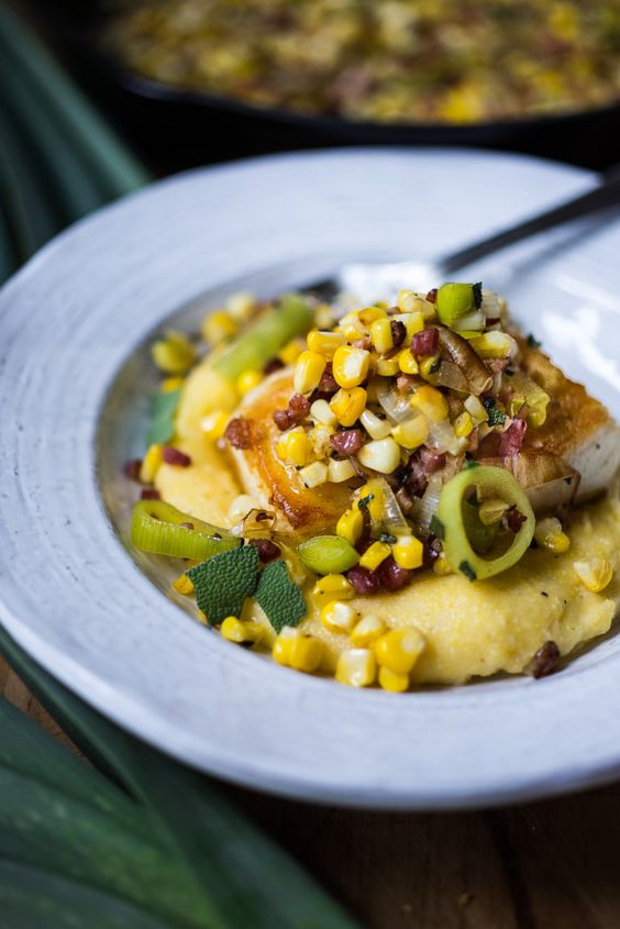 """A simple delicious recipe for Halibut with corn, pancetta and sage, served over a """"lightened-up"""" creamy polenta. And the best part is it can be made un under 30 minutes! 