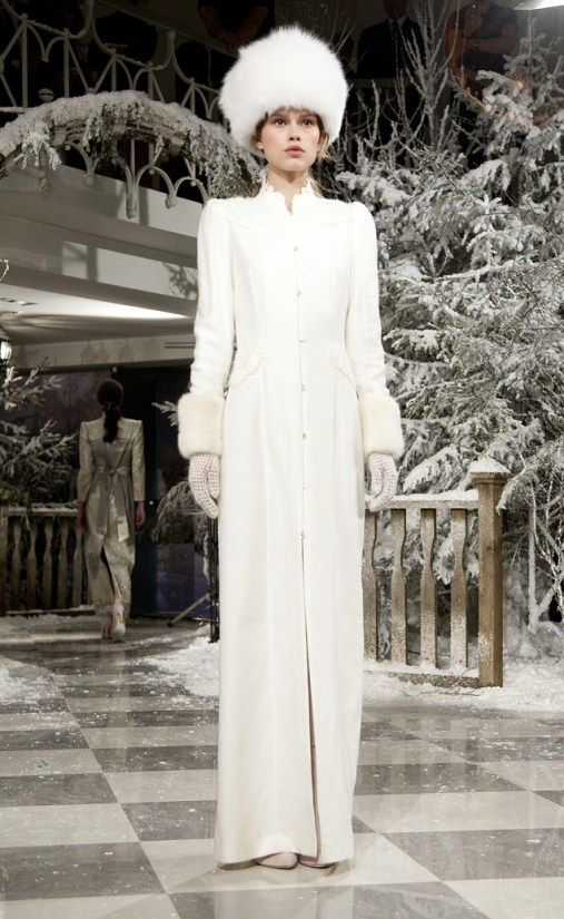 Russian bride's attire for a winter wedding. It is in the latest trends of fashion, warm and elegant.
