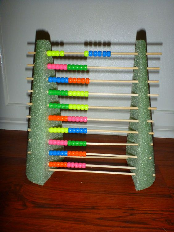 Abacus DIY:  Floral foam cone - cut in half  Scewers  Beads  simple, fast, very useful