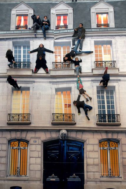 """Leandro Erlich - Batiment - The constructed building is typical Haussmann architecture with balconies that speaks to both Parisians and tourists — a real symbol of Paris. The building is horizontal, and the mirror offers the vertical sensation that invites visitors of all ages to """"climb"""" without any effort and defy the laws of gravity. Children and adults marvel at their suspended mirrored images — and kids have to be constantly reminded to not climb onto the mirror itself."""