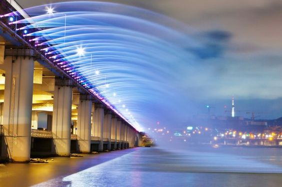 A tunnel of water and light... on a bridge