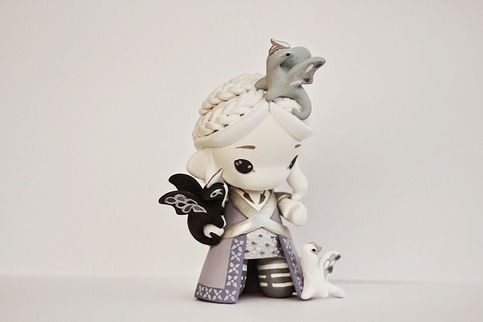 A Kidrobot Micro Munny turned into a Daenerys Targaryen custom - along with her 3 dragons!   She has a very detailed handpainted outfit, and intricate hairdo with braids and loose strands of hair, and a three headed Targaryen dragon tattoo on her back. :)  Ps: more pics on my blog: http://mijbilc