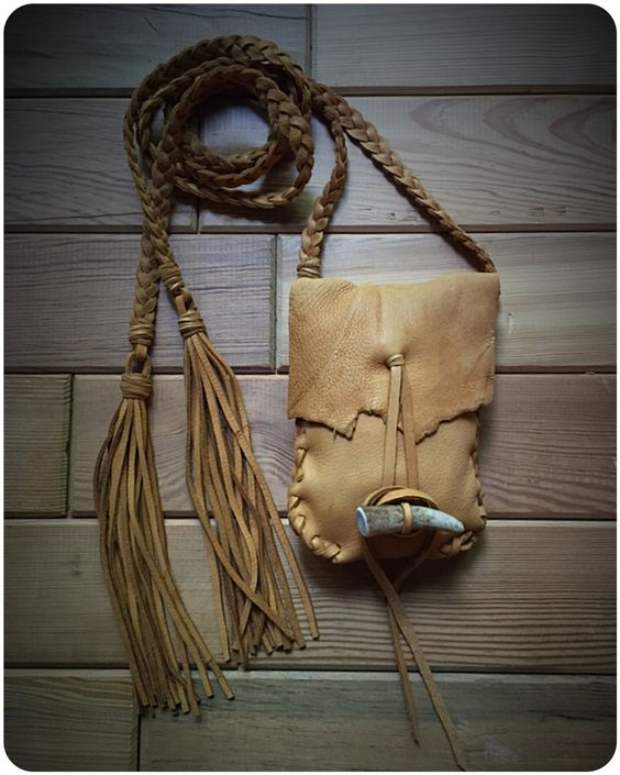 """Handcrafted from supple, strong deerskin leather.Bag is approximately 6.5"""" x 4.75"""".Super long straps, each one is 40  inches long not counting the length of the tassels.Natural antl..."""