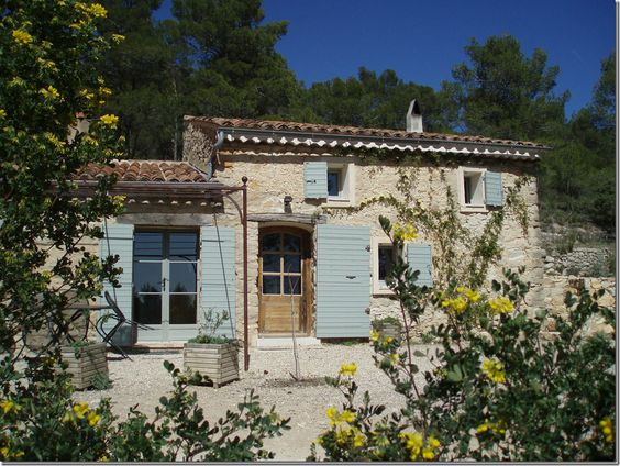 Best French country farmhouse exterior with shutters and pea gravel courtyard. #provence #frenchfarmhouse #frenchcountry #exterior