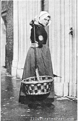 Above is a picture of a young peasant girl taken in 1906.   Although she is a member of the working class, the girl is well dressed in a traditional Dutch costume.  Her head is covered by a bonnet and she is carrying a large woven basket which is tied to what looks like a halter around her neck, presumably to help her carry the heavy load more easily.   The basket is empty so it is difficult to tell what she would normally have carried, but she likely would have used the basket to carry…