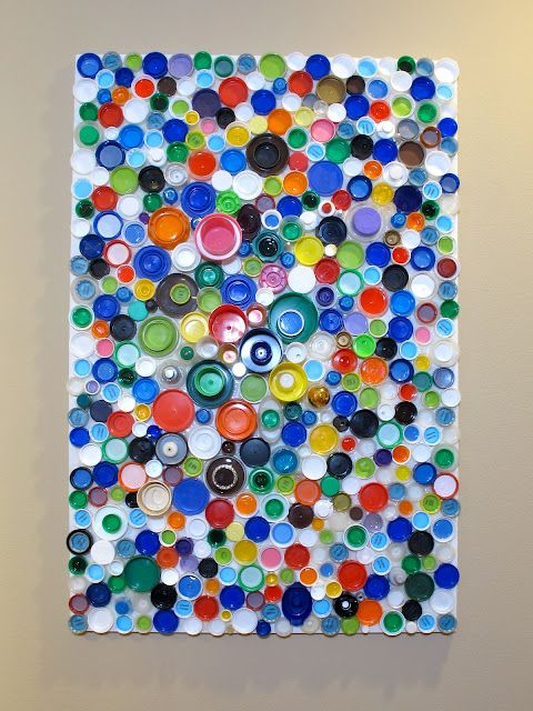 Here 39 s an idea for upcycled plastic bottle cap wall art for Bottle cap wall