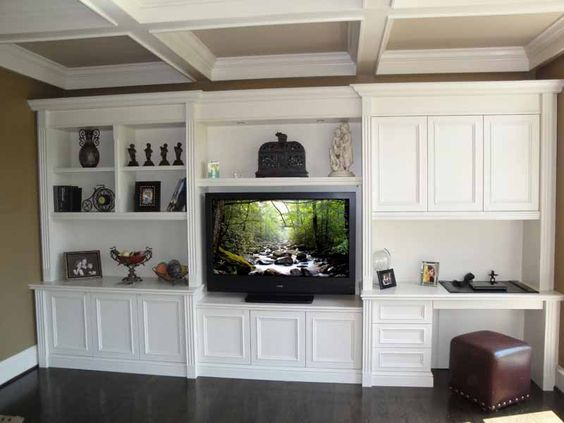Fluted built in design with my ceiling beams home for Media room built in cabinets