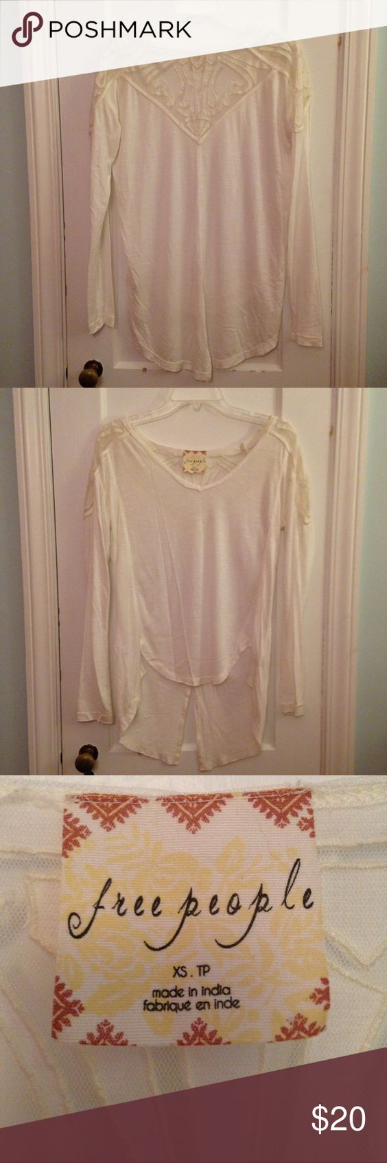 White Free People Long Sleeved Shirt White Free People Long Sleeved Shirt, with lace designs on the back/ shoulder area. Like new! Free People Tops Tees - Long Sleeve