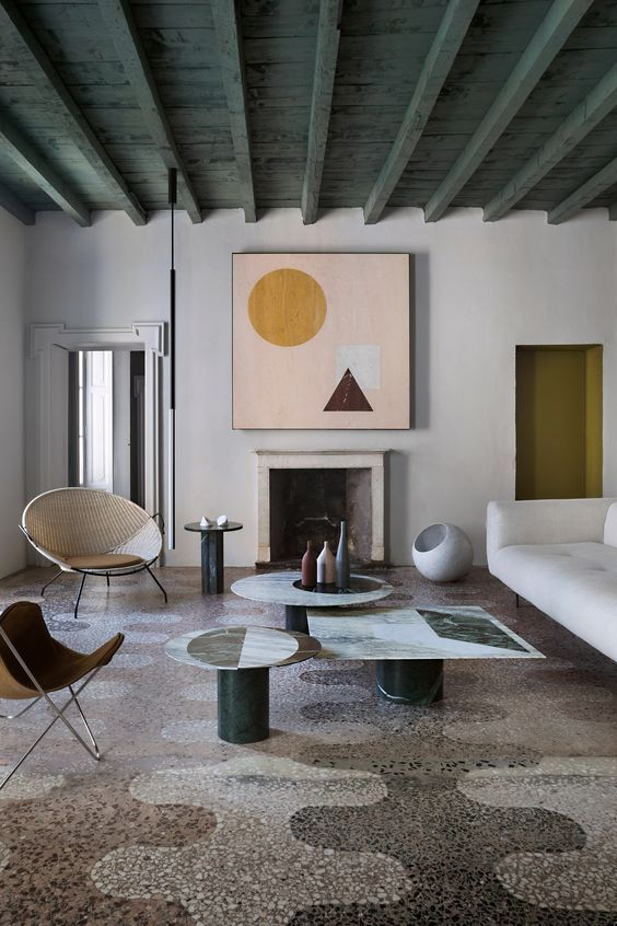 Casa Salvatori in Milan brings together marble furnishings and flecked terrazzo floors.