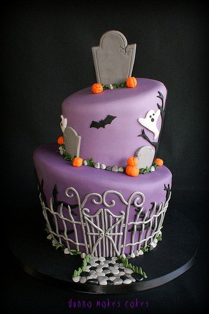 Awesomely creative, wonderfully decorated Halloween graveyard cake.