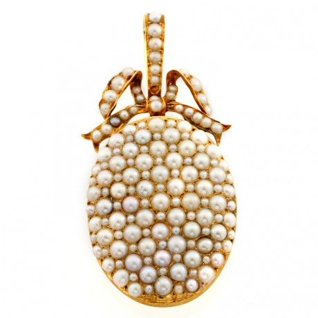 A victorian oval natural pearl locket, pave-set with natural pearls, c. 1840
