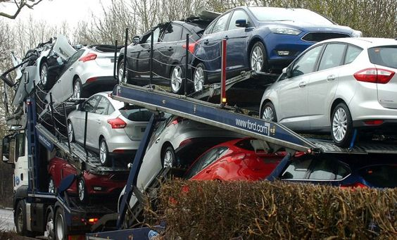 Fleet of new #Ford Focus cars wrecked after transporter wedged under low bridge. Ouch.
