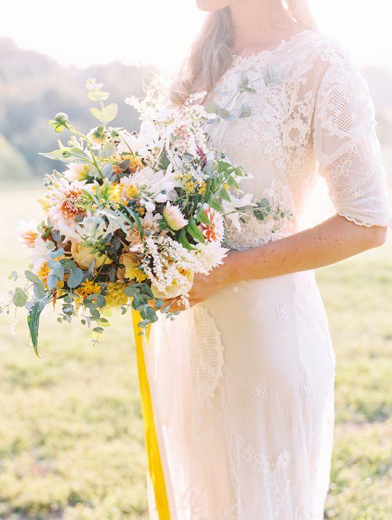 Wildly elegant yellow bouquet | 3/4 sleeve wedding dress: