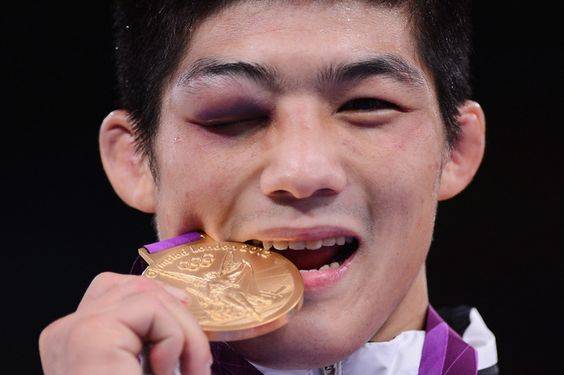Kim Hyeon-Woo of South Korea won the 66-kilogram gold in Greco-Roman wrestling with his right eye bruised shut.