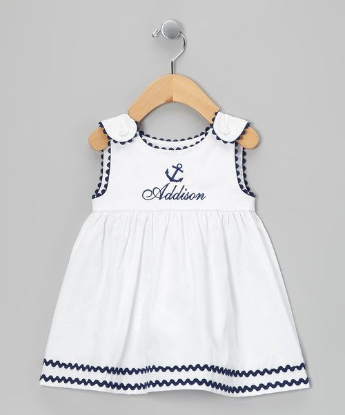 This breezy rickrack-trim dress features a high waist, lined bodice and covered button shoulder closures. Embroidered with an anchor, it makes for a perfect party frock when personalized with the name of the sweetie who's wearing it. Personalize up to 12 characters100% cottonMachine wash; tumble dry