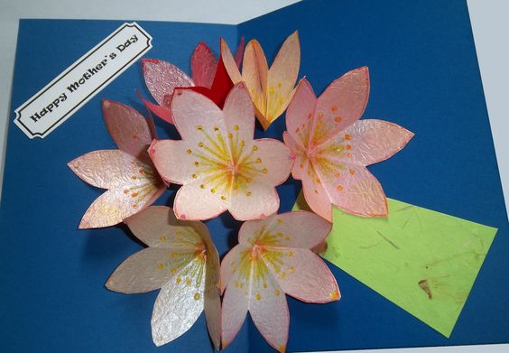 Seven flower pop-up card for Mother's Day.  Flowers created with origami paper, markers, ink, and iridescent paint.