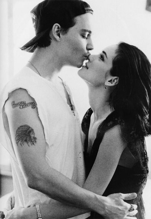 Johnny Depp  Winona Ryder You can tell just how much he loves her by the way he kisses her nose just so sweetly. She's overwhelmed by his passion for her.