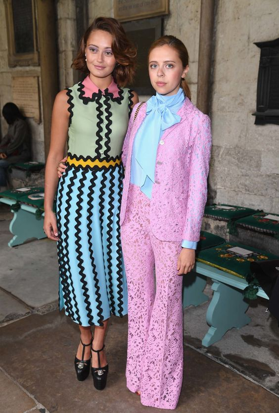 Ella Purnell (L) and Bel Powley attend the Gucci Cruise 2017 fashion show at the Cloisters of Westminster Abbey on June 2, 2016 in London, England.