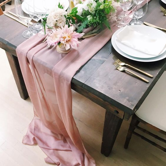 Our new blush color chiffon makes for a beautiful runner! Event planner: @jubileelau | Florals by @michaeldaigiandesign. @wildflowerlinen