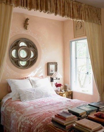 Gorgeous blush pink walls in a romantically charming bedroom designed by Penelope Bianchi.