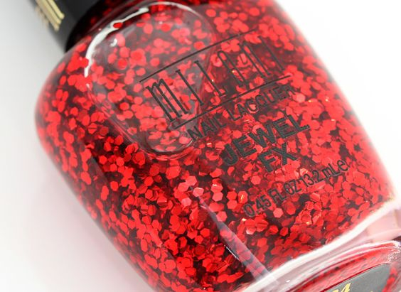 This looks like it's exactly the same as Deborah Lippmann Do You Think I'm Sexy. That makes me so excited because 18 dollars is way too much money to pay for what is essentially red craft glitter suspended in clear nail polish. 4.99 is far more palatable!