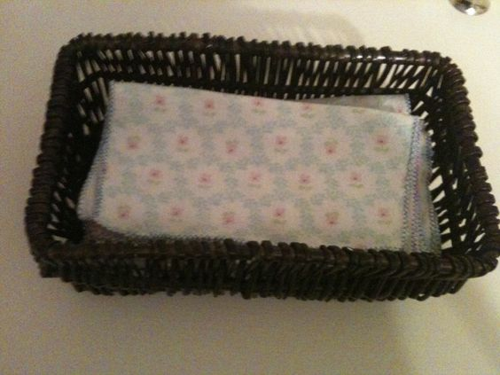 Reusable tissues, up-cycled from our old receiving blankets. I made loads of these and am storing them in several baskets around the house.