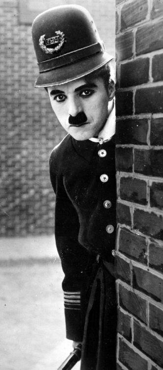 Charlie Chaplin in Easy Street c.1917.: