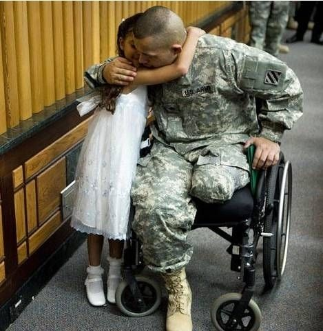 This wounded veteran who embraces his daughter after being awarded a Purple Heart:   22 Life-Affirming Photos Of Servicemen And Women Coming Home From Deployment