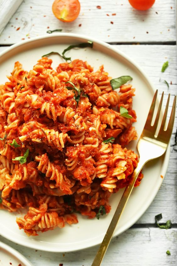 Simple, 30-minute Red Pasta Sauce with Red Lentils for added protein and fiber. Serve over gluten free pasta for a delicious plant-based meal!