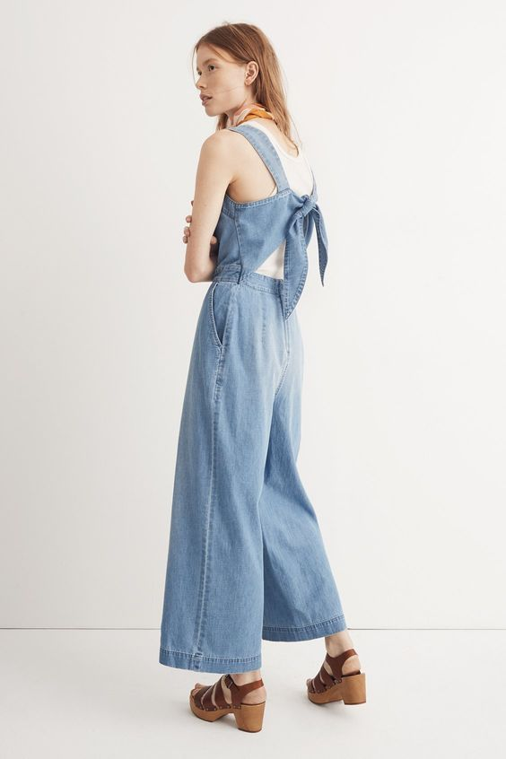 madewell denim tie-back jumpsuit worn with multistrap wood sandal + silk bandana. call 866 544 1937 or email shopfirst@madewell.com to pre-order.