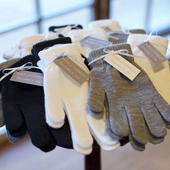 Want a favor that your guests will definitely use? Provide something that'll keep them warm through these frigid months, like gloves.:
