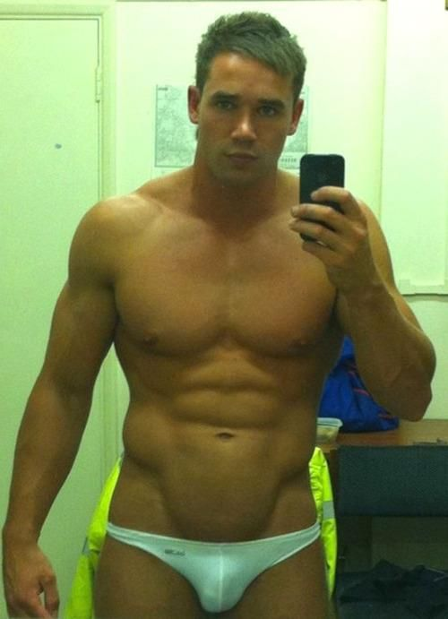 Muscles in a tiny speedo.