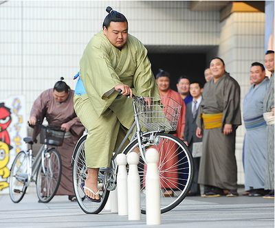 Sumo Wrestlers Attend Bicycle School in Tokyo