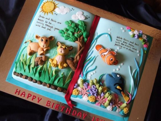 Storybook !  By: dods at CakeCentral, who sez:  This cake was for a 3 yr old girl who could not make up her mind if she wanted Lion King or Nemo. So her mother asked me to put both on a cake and I came up with the storybook idea...I think it turned out fine!!! Used a book pan. All mmf. Credits for the story on the book (painted) goes to my DH!!
