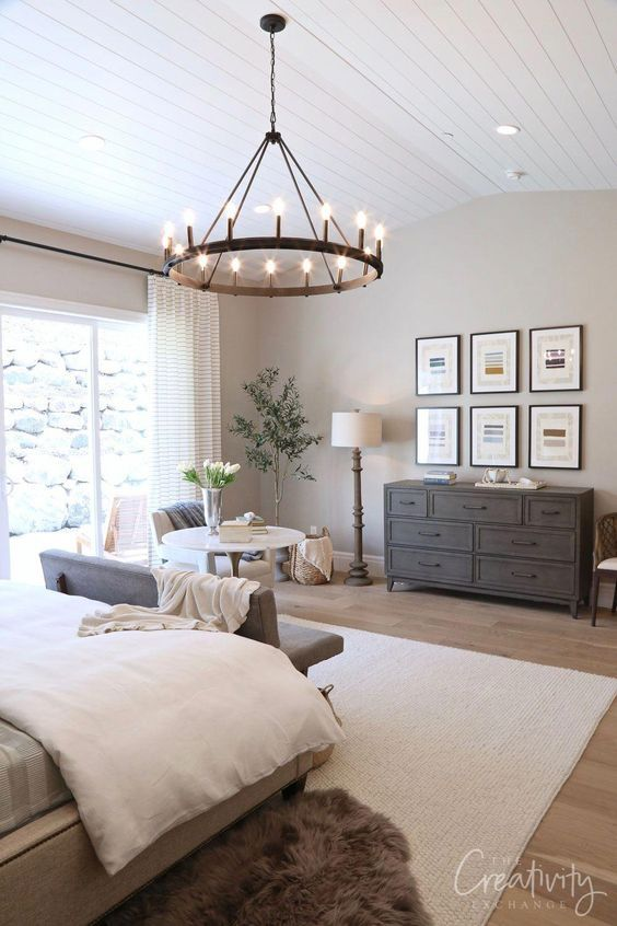 The farmhouse style is such a cozy, and homey trend style, like this lovely amazingly decorated bedroom with grey, white, and beige shades. Such a spacious bedroom, full of charm, and majestic. A very wide space at foot of the bed, to place a small living room, and a drawer cabinet. Our amazing chandelier is the main character in this look, it provides the marvelous touch, to make this bedroom look exactly what everybody deserves, and dreams about!