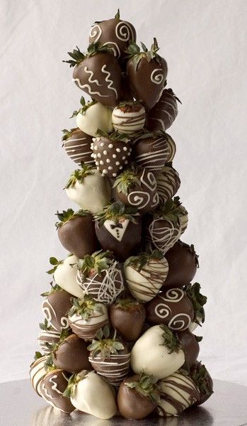 Chocolate covered strawberry tree.  This would be a great Christmas tree for the kitchen island but it wouldn't last one hour in my house.