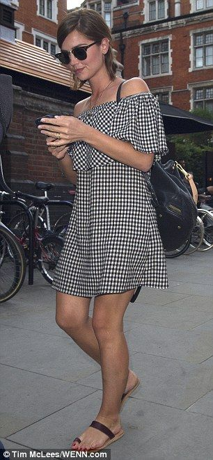 Chic: Jenna was stylish in an off-the-shoulder black and white dress which displayed her long legs