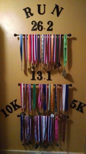 Running medals display wall