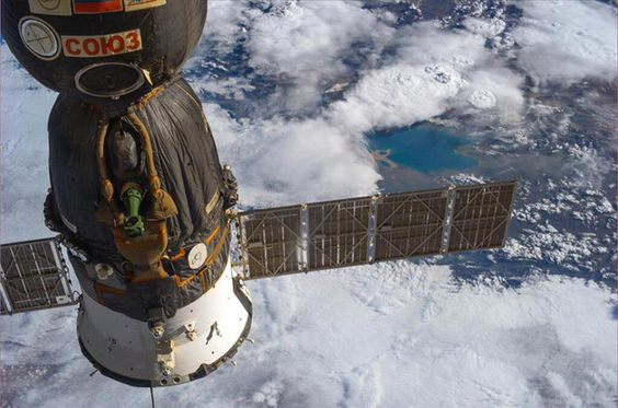 Photos from International Space Station; Koko Nor lake is visible above the Soyuz solar array as we fly over China.