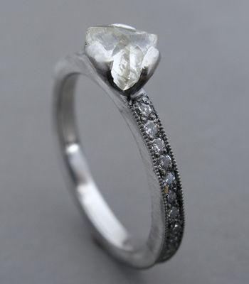 platinum ring with 0.90 carat uncut, triangular diamond and 2x2mm shank set with full-cut, bead-set diamonds