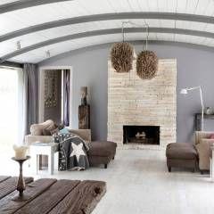 Haus Witzhave: koloniale Wohnzimmer von raphaeldesign