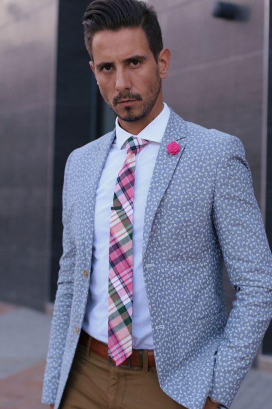 floral blazer, white shirt, pink tartan tie, pink lapel flower, tan leather belt, brown skinny chinos: