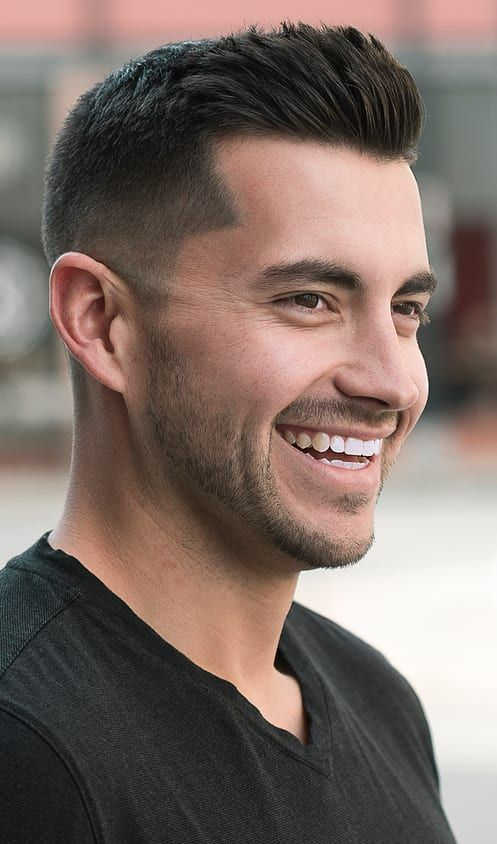 Clean Subtle Taper Fade - This clean, manly cut is long on top and short on the sides. A little overgrown facial hair and a smile adds plenty of character.