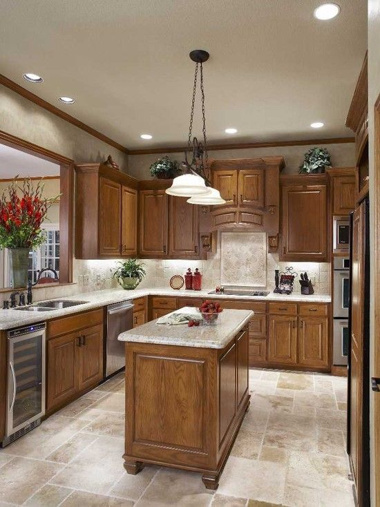 I love the tile and back splash in this kitchen i think for Well decorated kitchen