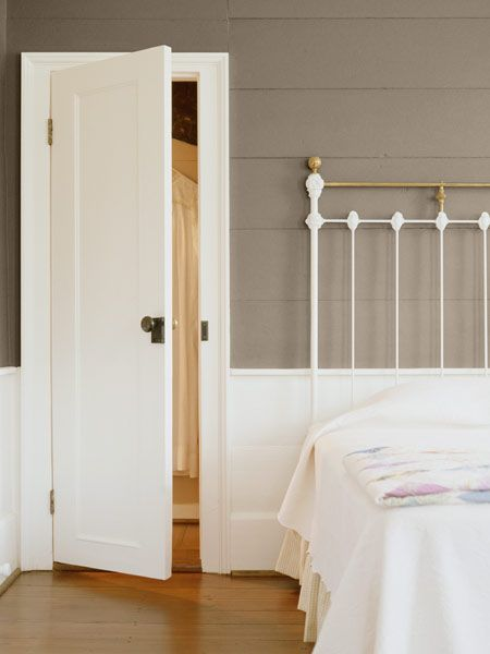 A muted tone on the walls allows the beautiful all-white molding and wainscoting take center stage in this cottage bedroom. | Family Tree (B13-2), @dutchboypaint