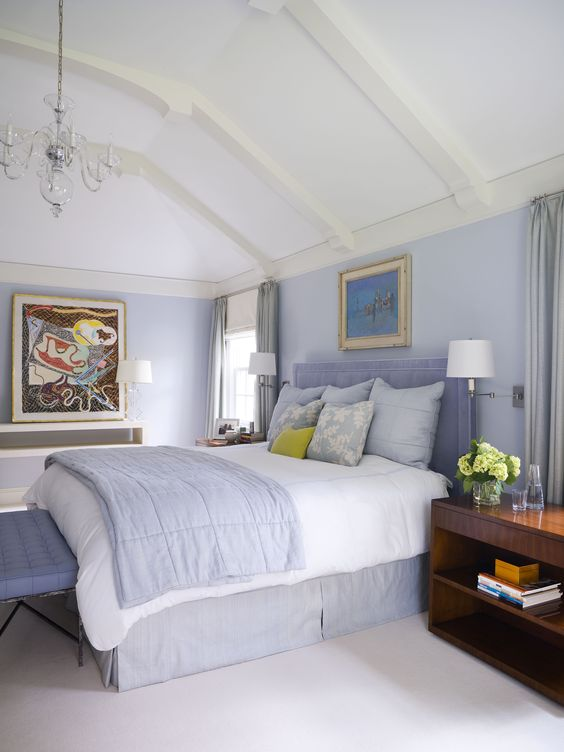 Great tall beamed ceiling in this periwinkle blue Master Bedroom  Pop of Green :)