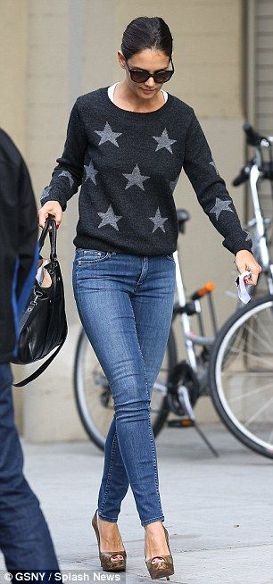 She's a star! The Bobbi Brown spokesperson shines in a grey star patterned sweater