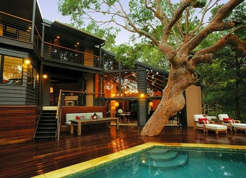 Modern Home With A Nice Wooden Deck And Swimming Pool In The