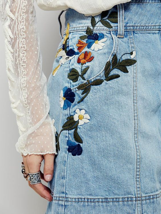 Jackson Embroidered Denim Skirt | This vintage-inspired denim mini skirt will have you dreaming of days past. Featuring floral embroidery along the hips and button detailing up the front. Rigid cotton fabric and A-line silhouette with hip pockets. Easy, effortless fit.: