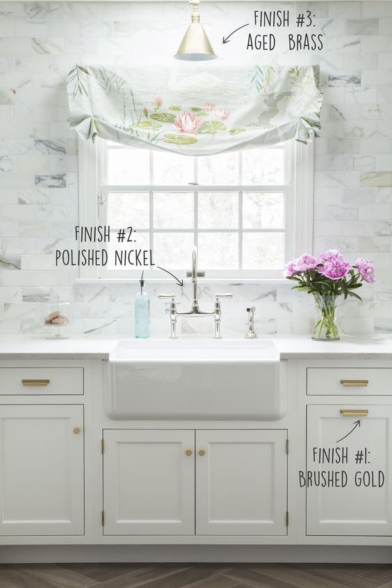 How to mix and match metals in a kitchen. Farmhouse sink with polished nickel faucet. Brushed gold pulls from Caitlin Wilson